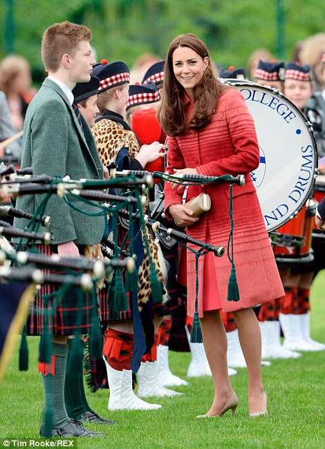 All smiles: The Duchess appeared to be enjoying herself during the visit