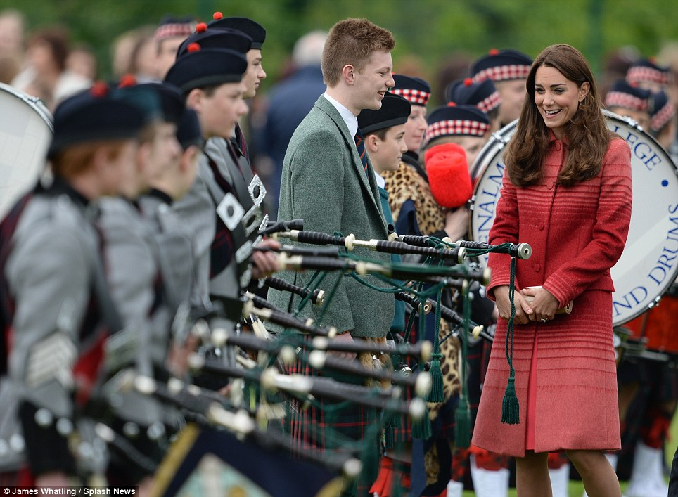 Glamorous: The Duchess looked wonderful in a crimson Jonathan Saunders coat, Goat shift dress and her trademark nude L.K Bennett 'Sledge' heels
