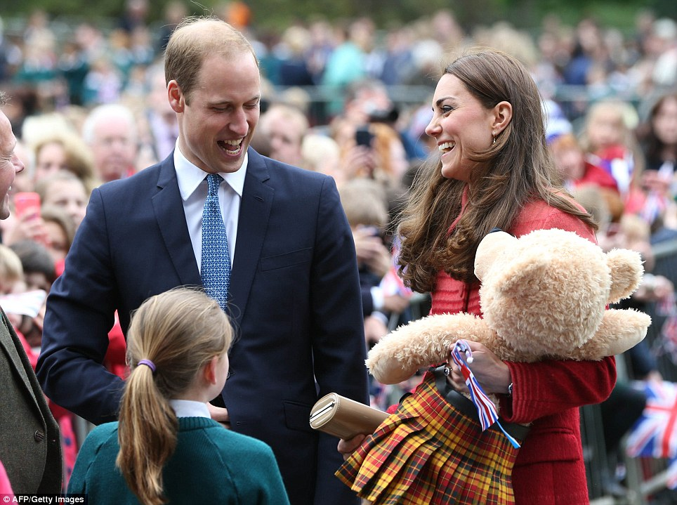 Is that for George? The royal couple were wreathed in smiles after being presented with a huge teddy bear that sported a kilt