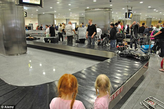 Dangerous places?: 21 per cent of passengers get hurt at baggage carousels, according to the survey