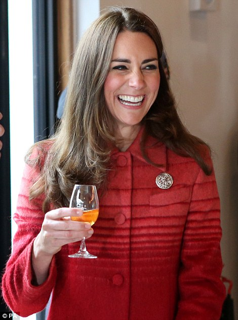 Cheers! The Duchess of Cambridge beams as she sips her whiskey