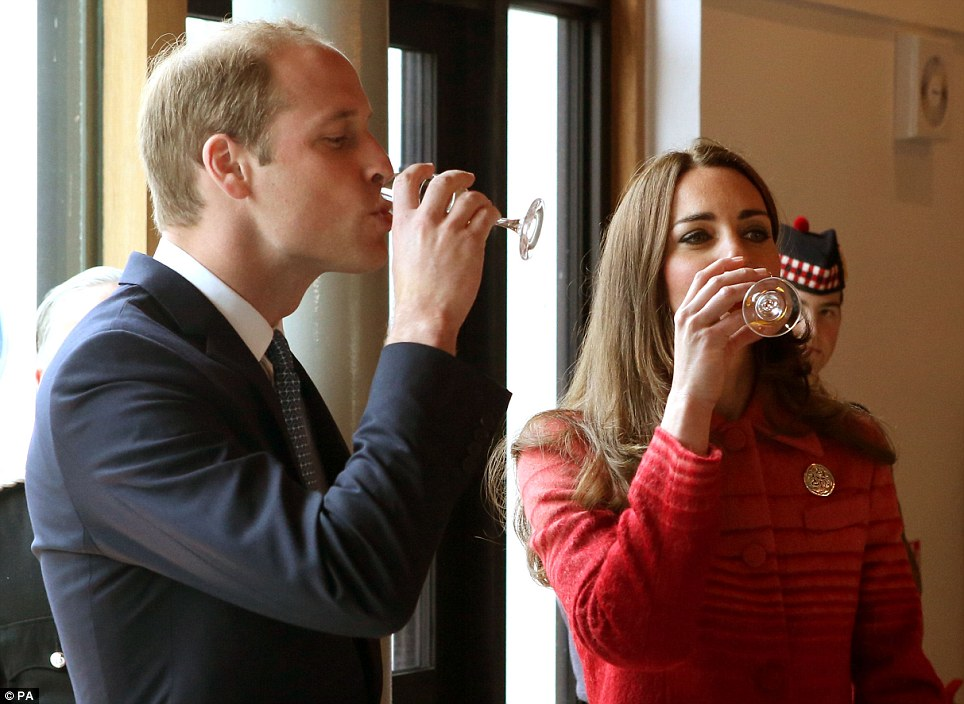 Down in one! The Duke and Duchess of Cambridge enjoy a glass of single malt whisky during a tour of The Famous Grouse Distillery in Crieff