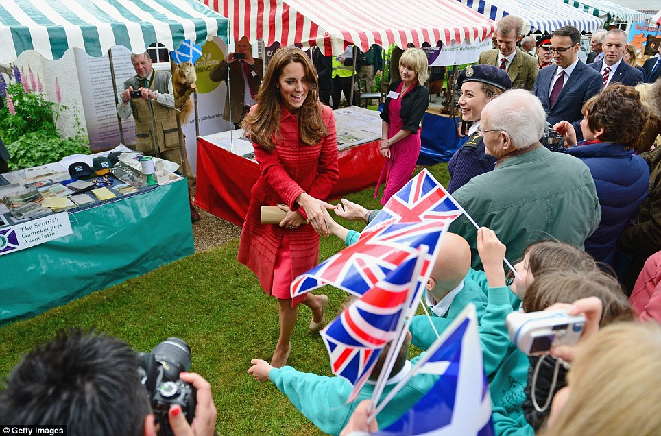 A very British day out: The Duchess of Cambridge arrives at Forteviot village fete, walking just ahead of John Dewar, scion of the Dewar whisky dynasty