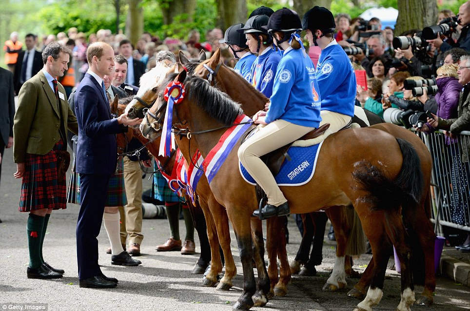Pony club: Prince William lets a naughty palomino pony lick his fingers as he meets beautifully turned out riders lined up at the Forteviot village fete