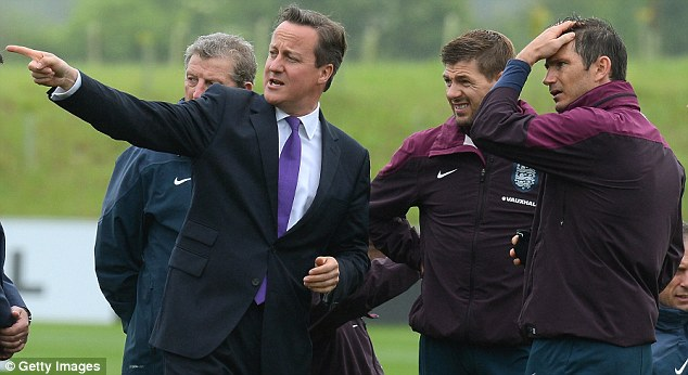 Pointing the way to goal: Gerrard and Lampard look impressed as Cameron points something out in the distance