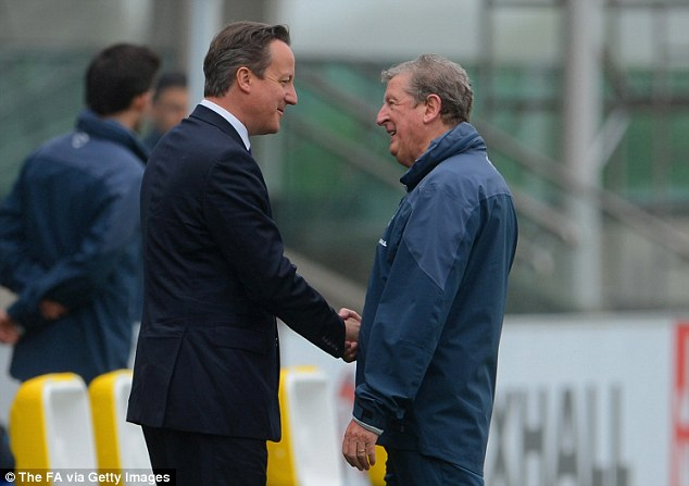 Tough jobs: Cameron and Hodgson shakes hands as the Prime Minister visited the national football centre