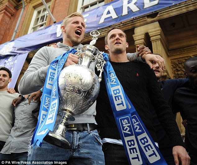 Going up: Schmeichel celebrates promotion with Andy King