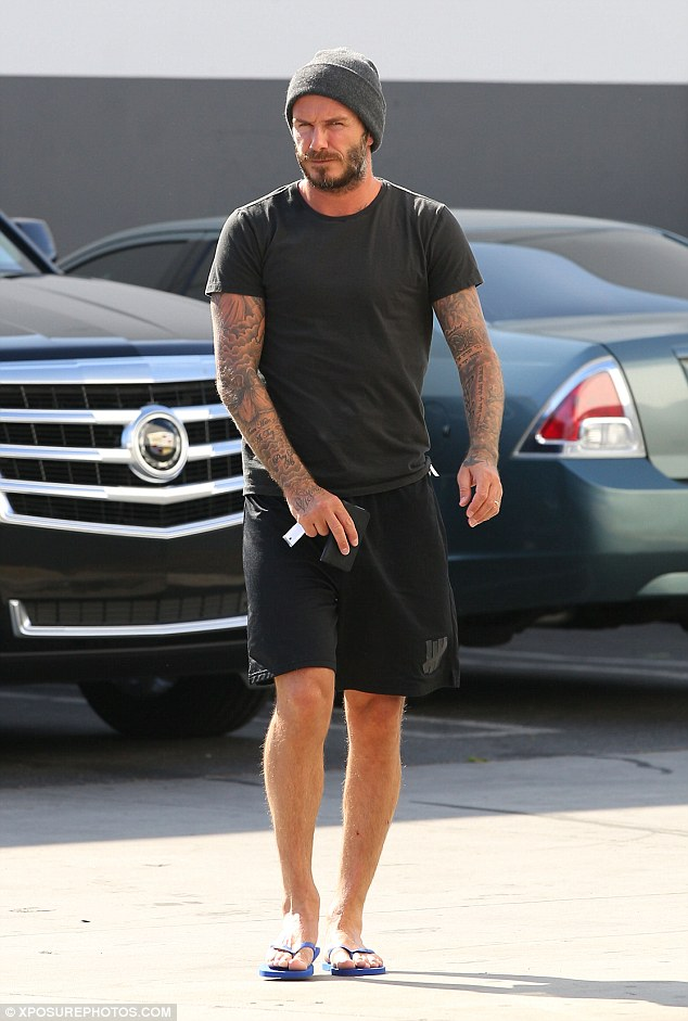 Routine: The father of four hit the same gym on Wednesday in a pair of flip flops