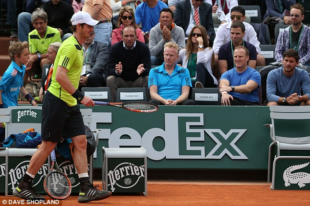 Vacancy: Andy Murray walks past empty seats in his box during his French Open second-round victory