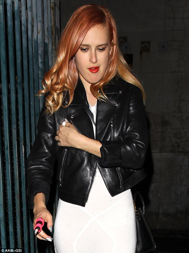 Injured? Rumer displayed a black and pink bandage on her finger as she made her way into the club