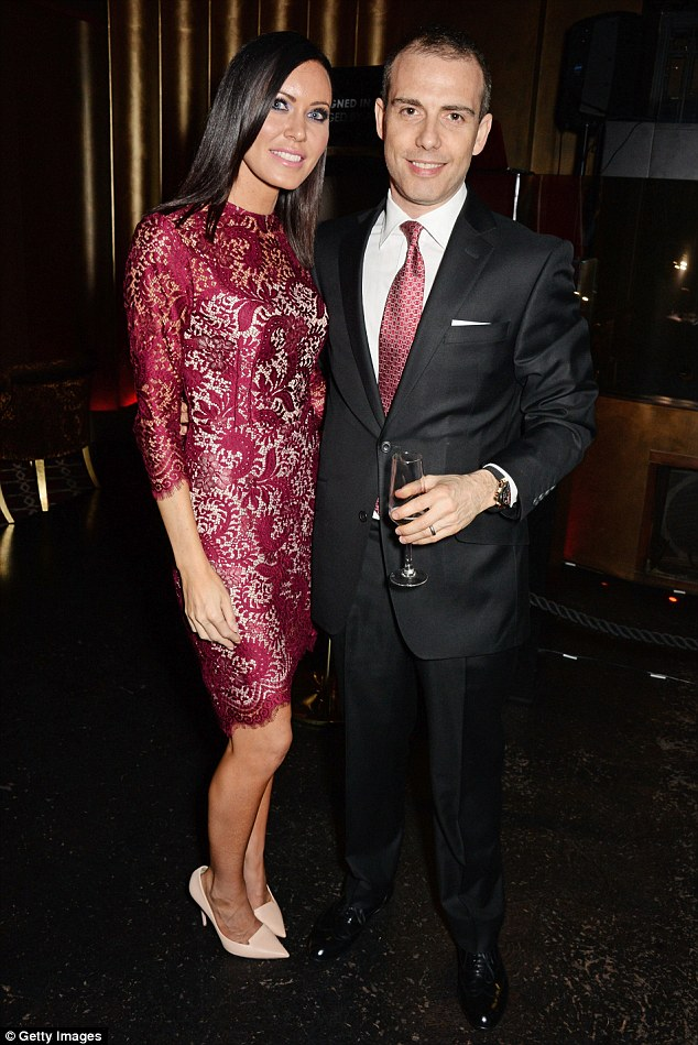 Coordinated: Linzi Stoppard's red lace dress matches her husband Will's tie
