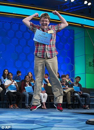 Eighth grader reacts after correctly spelling the word 'harlequinade' during the semifinals of the Scripps National Spelling Bee