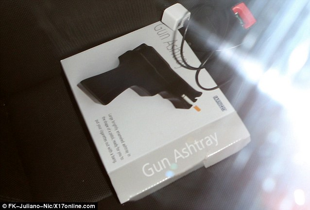 Gun culture: There was a questionable gun shaped ashtray spotted in the front of Justin's car