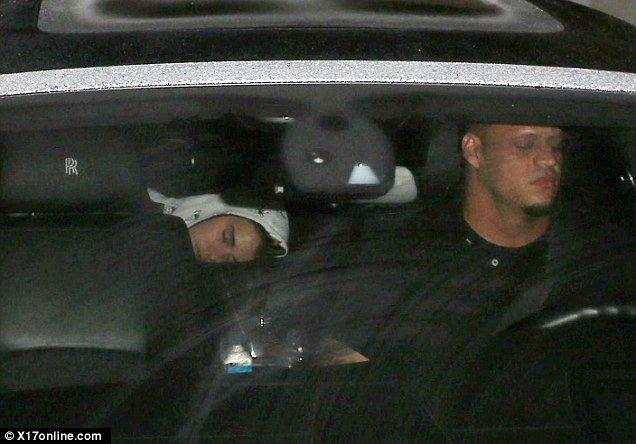 Tired Baby? Justin looked like he had exhausted himself in the recording studio as he napped in the back of his car