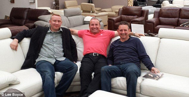 Popular man: Dave with Mark Ruge (left), owner of Furnimax and his first ever saver Tim (right).