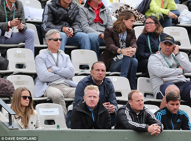 Hovering: Amelie Mauresmo (back 2nd right) watched Murray's Roland Garros opener on Tuesday