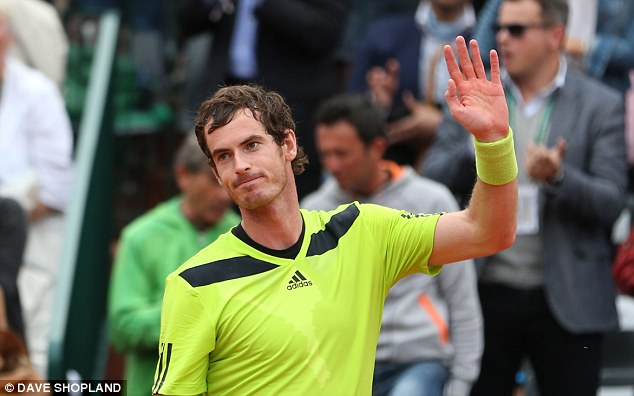 Happy man: Murray waves to the crowd after booking his place in the third round of the French Open