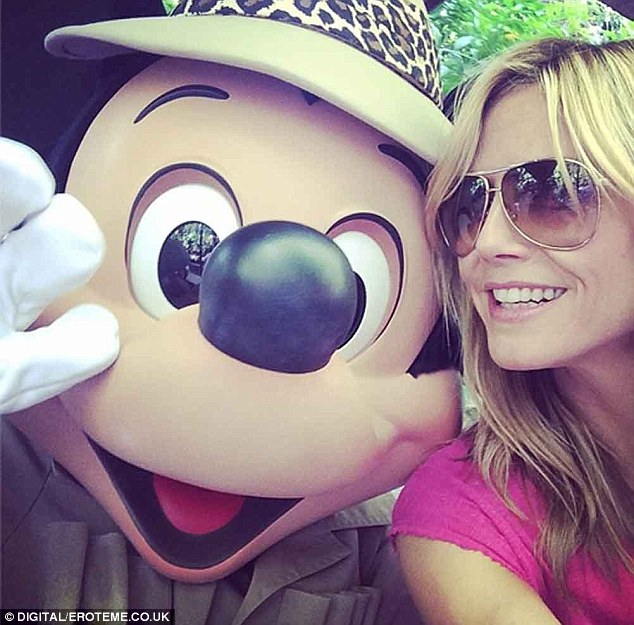 'Great day at Disneyland!' Heidi shared a happy snapshot of her and Mickey Mouse with her social networking followers on Thursday