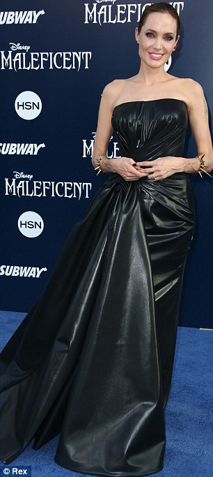 Into the spirit: Angelina was channelling her evil fairy character with her leather-look black dress and spiky jewellery