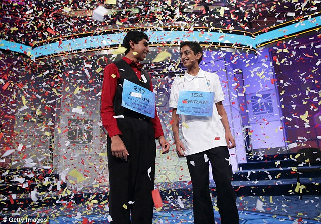 Celebration: Confetti falls after Sriram Hathwar (right) Ansun Sujoe (left) both won the 2014 Scripps National Spelling Bee competition May 29, 2014 in National Harbor, Maryland