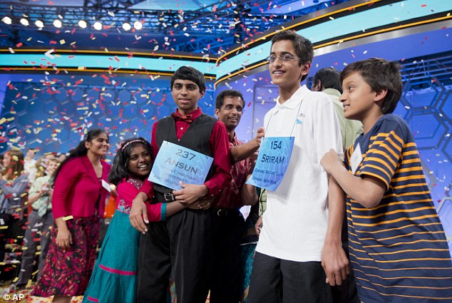 Proud moment: The 2014 Scripps National Spelling Bee Co-Champions Ansun Sujoe, of Fort Worth, Texas, and Sriram Hathwar, of Painted Post, N.Y., celebrate with their families