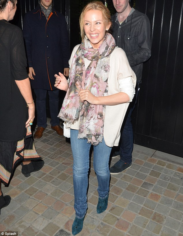 Got the giggles: The pint-sized singer showed off her slim frame in pale skinny jeans