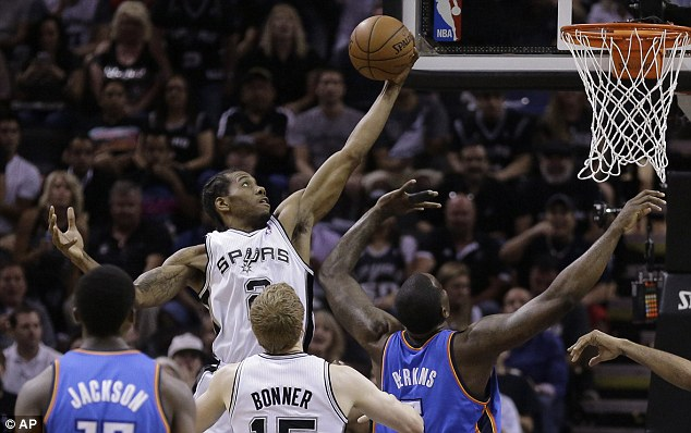 To the hoop: Kawhi Leonard scored 14 points as the Spurs once again shared their scoring load