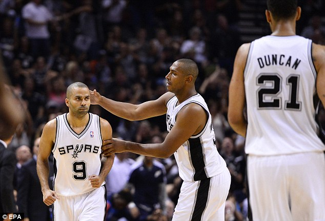 Rout: Tony Parker celebrates as the San Antonio Spurs smashed the Thunder to moves 3-2 ahead