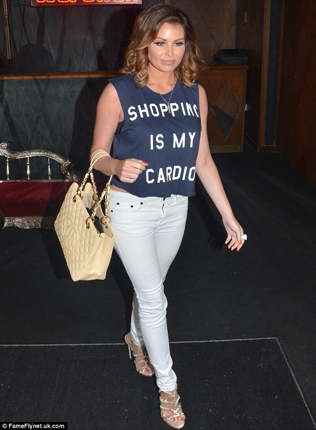Strut: She also opted for strappy silver sandals while carrying a cream Chanel tote