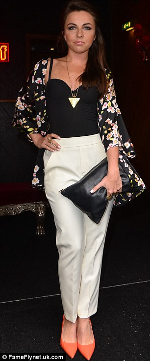 Working it: While Louisa clutched a large black handbag
