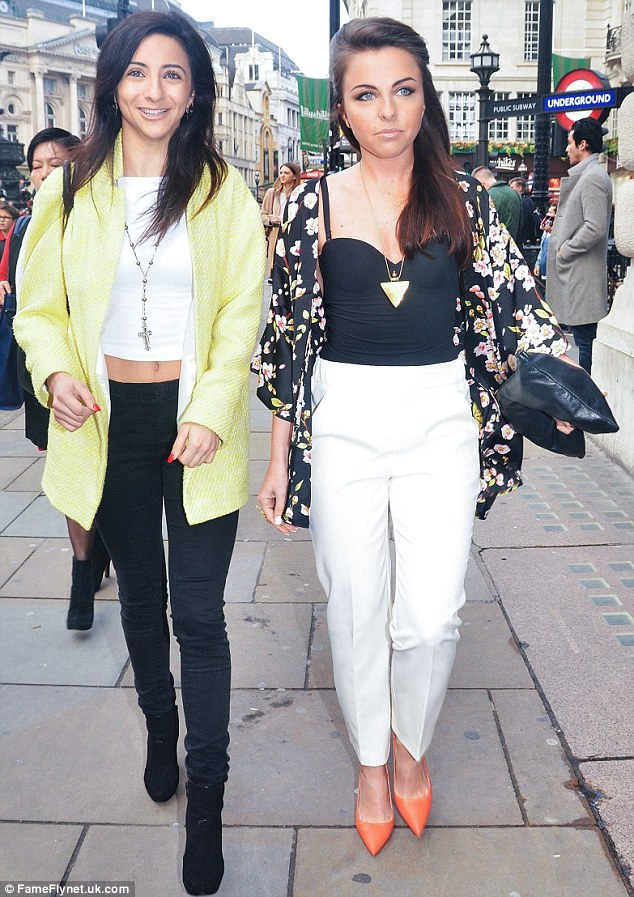 Fashionista: The EastEnders star, pictured with a pal, injected some colour into her ensemble thanks to an orange pair of stilettos