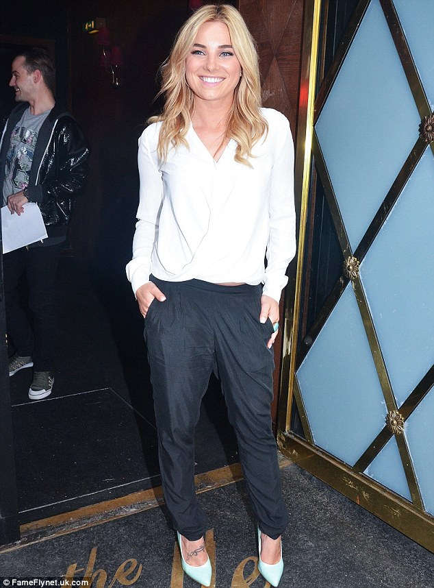 Monochrome: Sian Welby kept her slim frame under wraps thanks to her harem-style trousers and white blouse