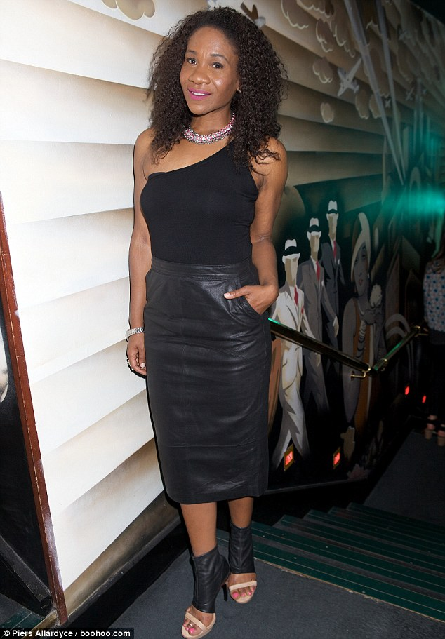 Keeping it simple: Karen Bryson showed off her curves in a leather pencil skirt and asymmetrical top