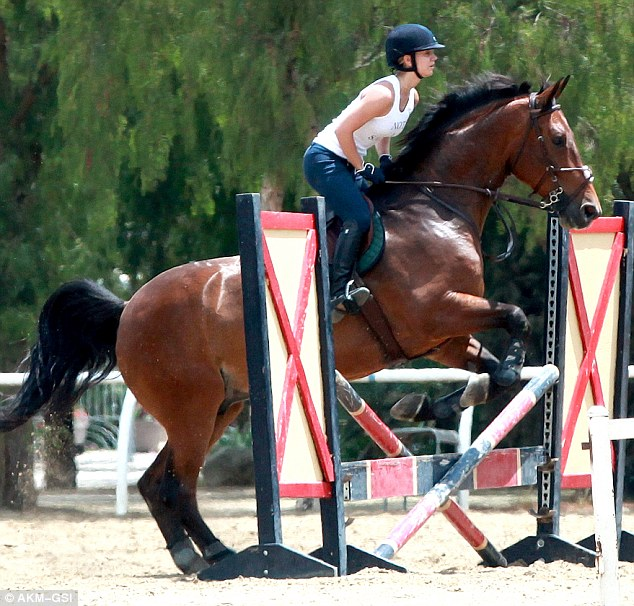 Horsing around! Kaley showed off her equestrian skill as she put her beloved horse Thor over a series of jumps