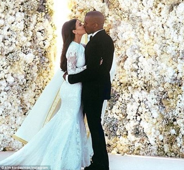 That kiss: This wedding photo Kim Kardashian posted of herself being kissing by new husband Kanye West in Florence, Italy on Saturday is the most 'liked' photo ever on the site