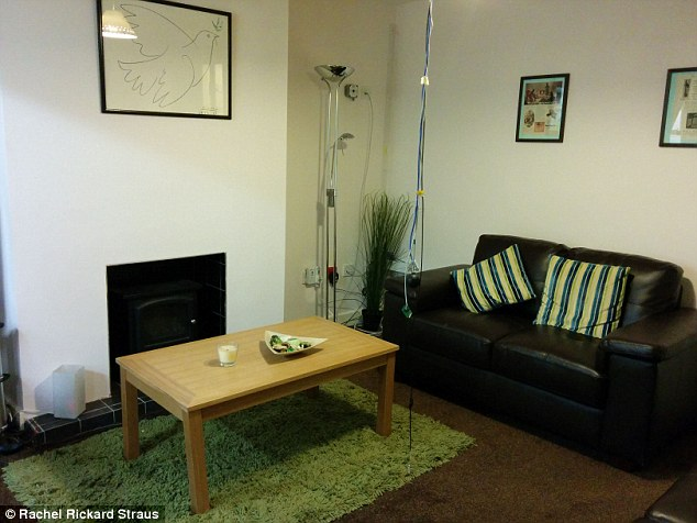 Cosy indoors: The terraced house looks like any other home - except for the sensors and cables hanging from the ceiling