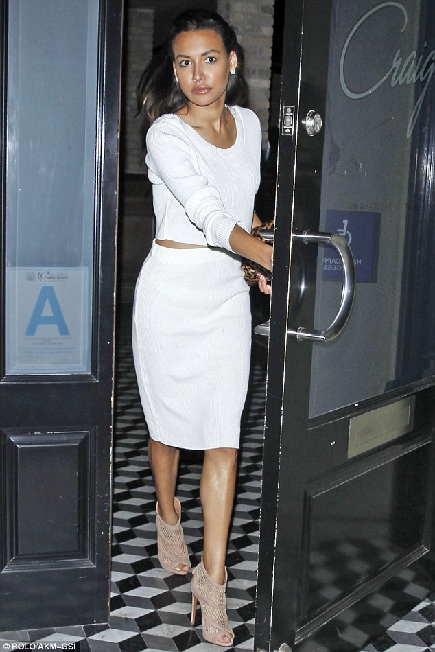 Heading out: She wore natural make-up which accented her bronzed glow