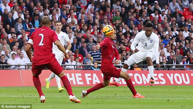 Class act: Daniel Sturridge curls home the opener after 32 minutes to put England on the road to victory