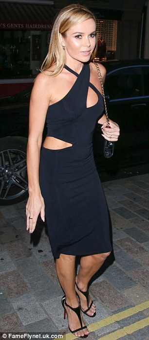 Incredible: Britain's Got Talent judge Amanda Holden, another arrival on the night, looked amazing in a black halterneck cut-out dress