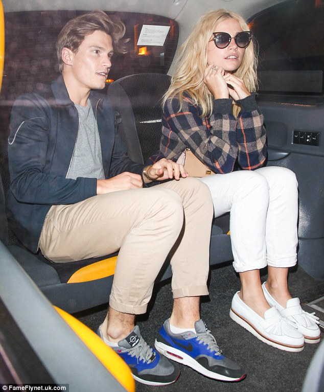 Party time: Pixie Lott arrives with boyfriend Oliver Cheshire