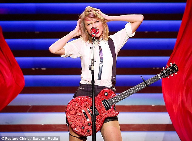 Here comes trouble! The singer takes to the stage with her electric guitar in Shanghai