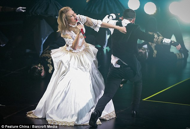 Sweeping statement: There were numerous costume changes for Taylor during another theatrical stage display on Friday evening