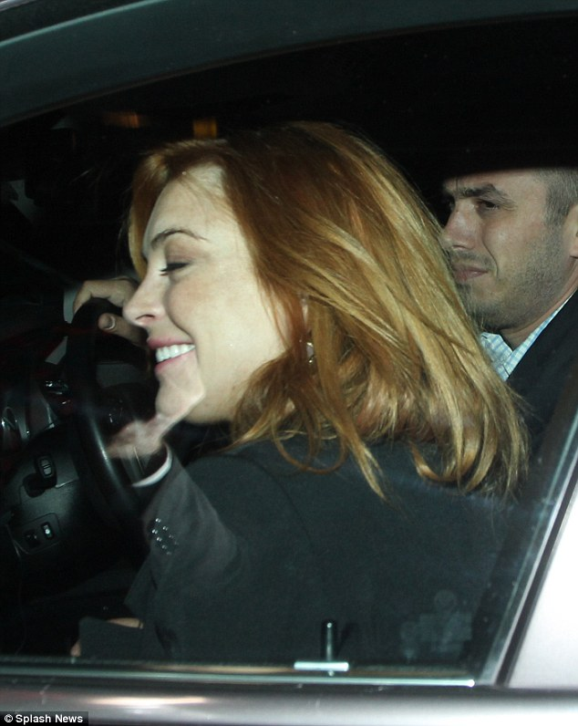 Good times: Lindsay appeared to be leaving in high spirits