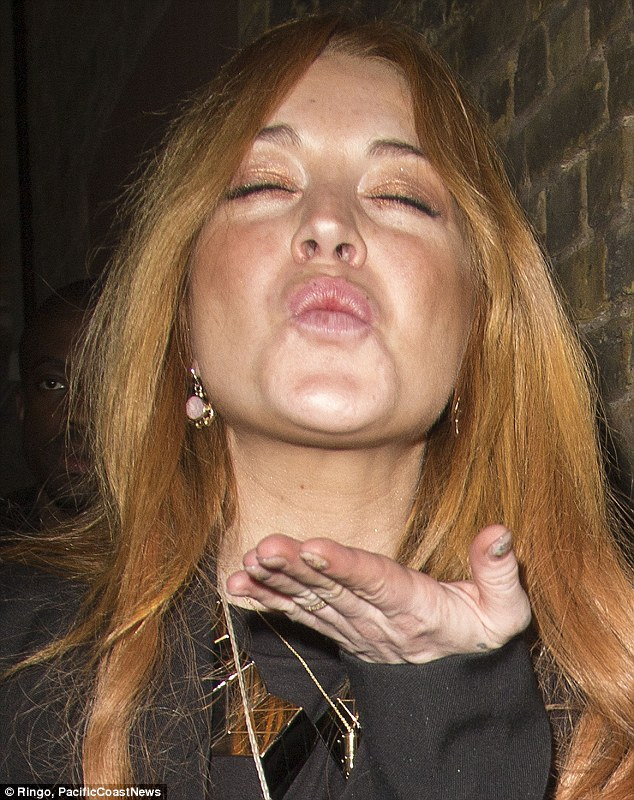 Love ya! Lindsay Lohan belw kisses as she left the Chiltern Firehouse in London on Friday