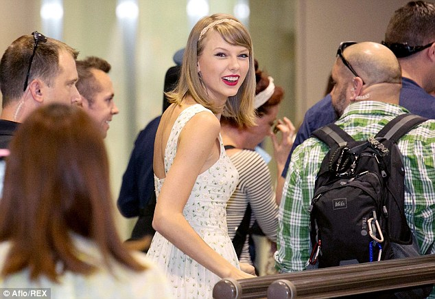 High spirits: Taylor was in a cheerful mood after arriving in Japan to fulfill tour dates for her Red world tour