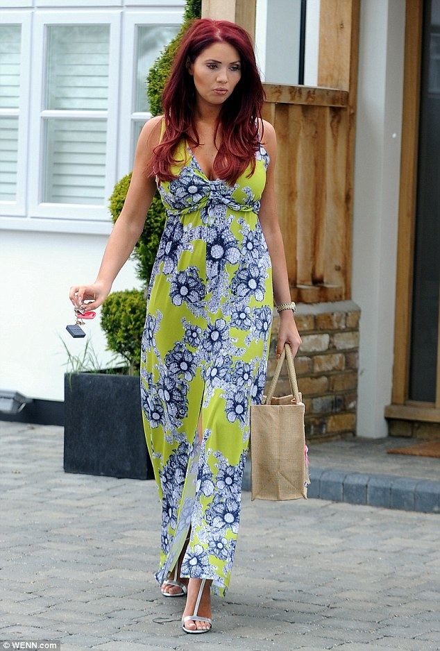 Flower power: Amy Childs stepped out wearing a dress from her own collection on Saturday as she headed to her salon in Essex