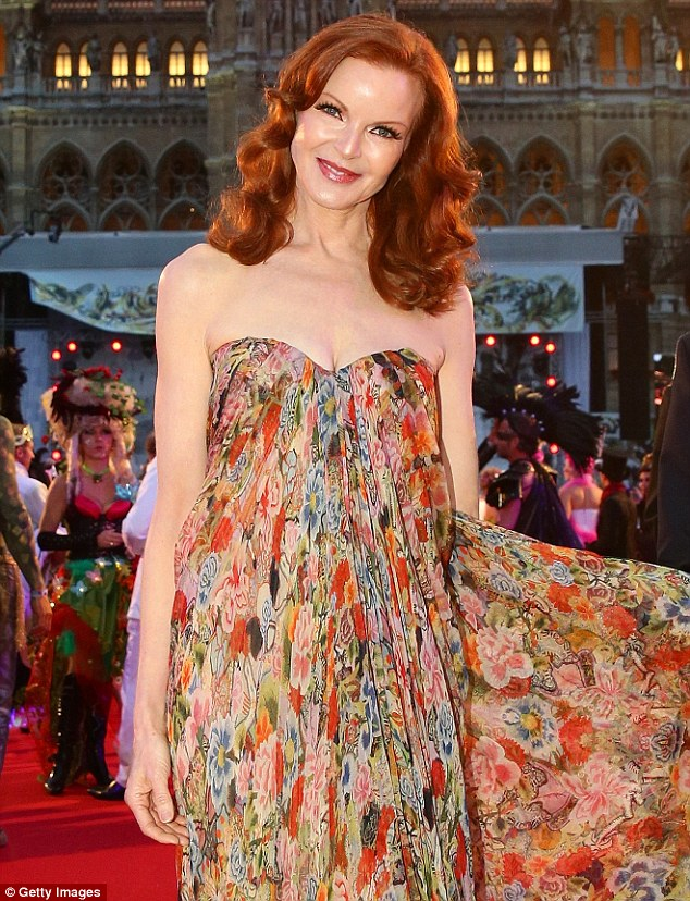 Striking: The 52-year-old actress opted for a colourful floral patterned bandeau dress