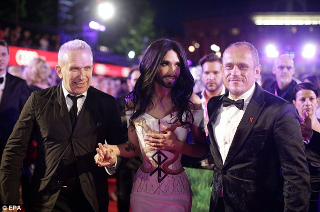 Three's company: Jean Paul and Conchita are joined by Life Ball organizer Gary Keszler
