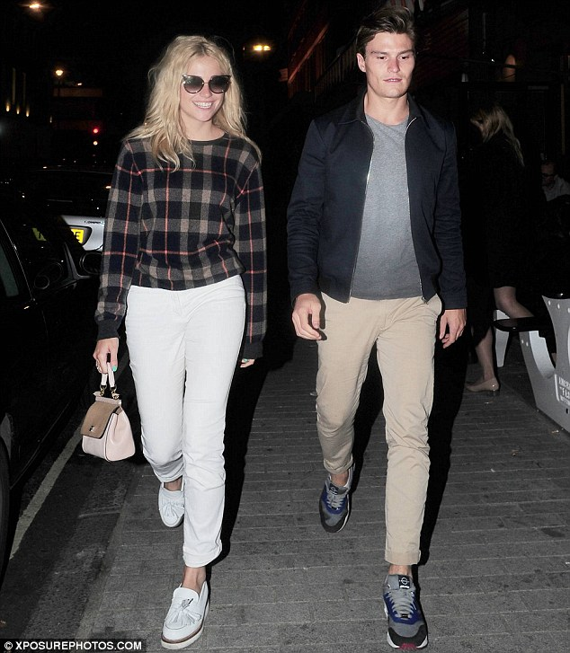 Cool customers: The singer kept her trim figure under wraps in a white pair of jeans and checked jumper