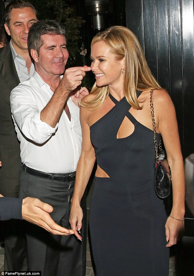 Playful: Simon jokingly grabbed Amanda's nose as they made their way home, and luckily she saw the funny side